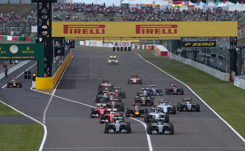 Lewis Hamilton (GBR) Mercedes AMG F1 W06 and Nico Rosberg (GER) Mercedes AMG F1 W06 battle for position at the start of the race - Formula 1 Round 14 at Suzuka International Racing Course, Suzuka Japan, Sunday 27th September 2015 +++ Photo: RACE-PRESS